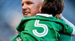 Ireland captain Paul O'Connell carries his son Paddy from the pitch at the end of the game