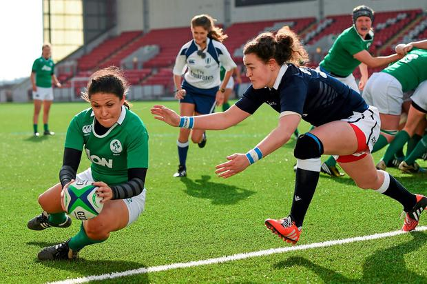 Tania Rosser, Ireland, goes over to score a second half try despite the tackle of Mhairi Grieve, Scotland