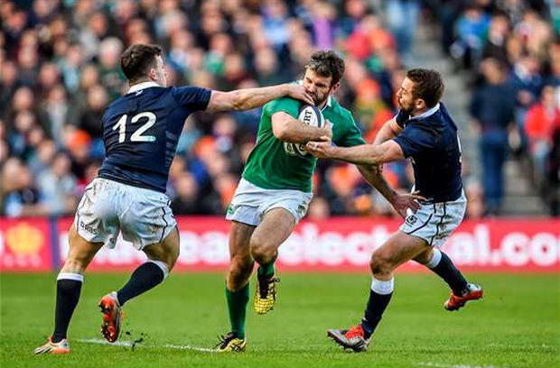Jared Payne, Ireland, is tackled by Matt Scott, left, and Greig Laidlaw, Scotland. RBS Six Nations Rugby Championship, Scotland v Ireland (Brendan Moran / SPORTSFILE)