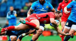 Wales' Jamie Roberts is tackled during their Six Nations match against Italy