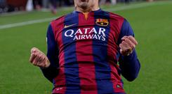 Barcelona's Luis Suarez celebrates after scoring his team's second goal during a Spanish La Liga soccer match between FC Barcelona and Real Madrid at Camp Nou stadium, in Barcelona. (AP Photo/Manu Fernandez)