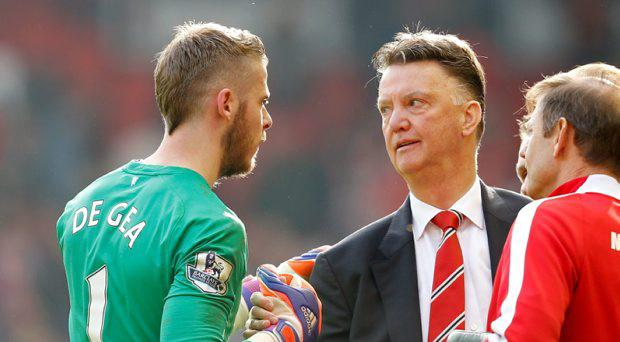 Manchester United manager Louis van Gaal celebrates with David De Gea at full time