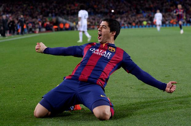Barcelona's Luis Suarez celebrates after scoring his team's second goal during a Spanish La Liga soccer match between FC Barcelona and Real Madrid