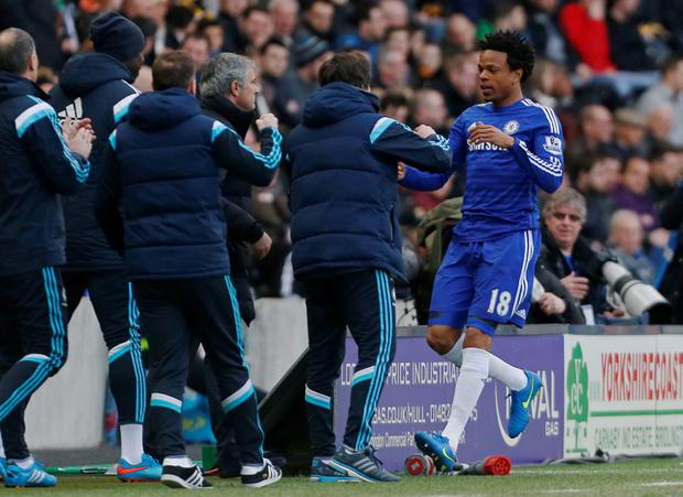 Loic Remy celebrates with manager Jose Mourinho and staff after scoring the third goal for Chelsea