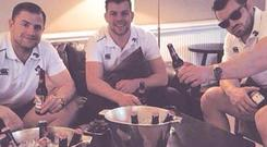 Jordi Murphy celebrating with Jamie Heaslip and Cian Healy