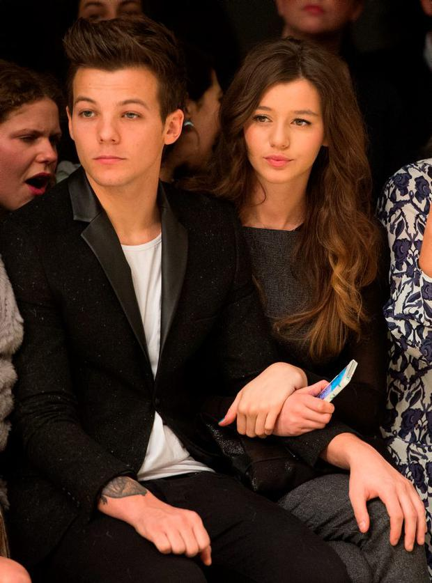 Louis Tomlinson of One Direction and Eleanor Calder attend the Topshop Unique show at the Tate Modern during London Fashion Week Fall/Winter
