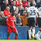 Liverpool's Mario Balotelli clashes with Manchester United's Chris Smalling Action Images via Reuters / Carl Recine
