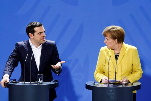 German Chancellor Angela Merkel, right, and the Prime Minister of Greece Alexis Tsipras had a 'tense encounter' (AP Photo/Markus Schreiber)