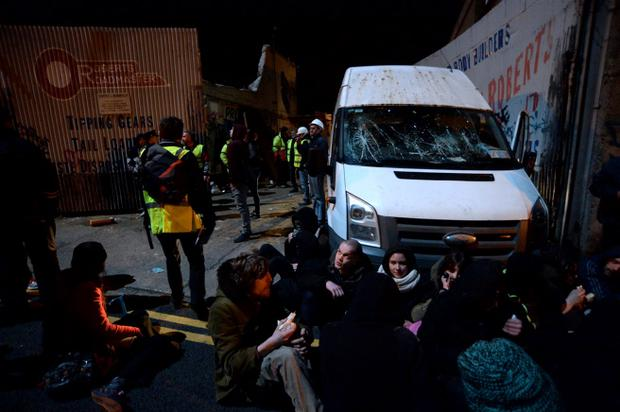 Protestors sitting down in front of van (with smashed windscreen) that tried to exit from site at Grangegorman lower, Dublin