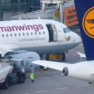 Germanwings and Lufthansa aircraft parked on the apron at Dusseldorf airport March 24, 2015. REUTERS/Ina Fassbender