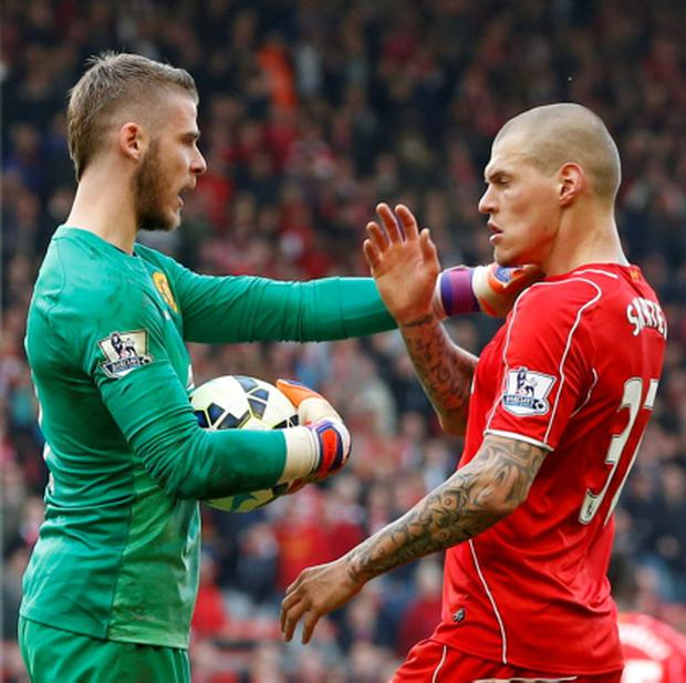 Liverpool's Martin Skrtel clashes with Manchester United's David De Gea