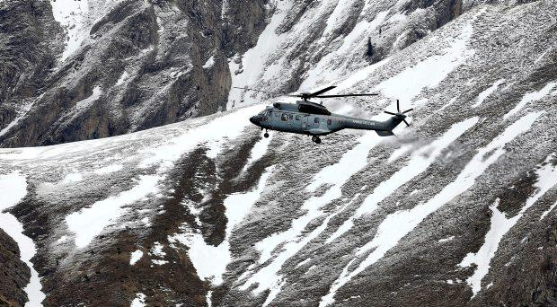 A French army helicopter heads to the Germanwings flight crash site near Seyne-les-Alpes, Wednesday, March 25, 2015, after the jetliner crashed Tuesday in the French Alps