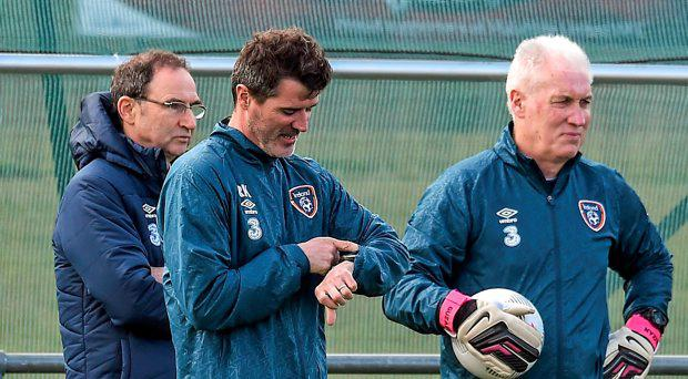 Republic of Ireland assistant manager Roy Keane, centre, with manager Martin O'Neill and goalkeeping coach Seamus McDonagh during squad training. Gannon Park, Malahide, Co. Dublin