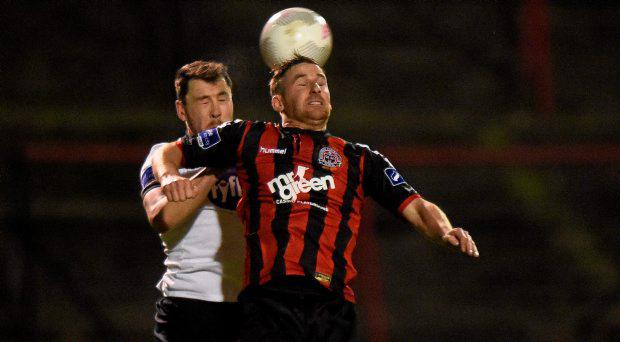 Brian Gartland, Dundalk, in action against Dean Kelly, Bohemians