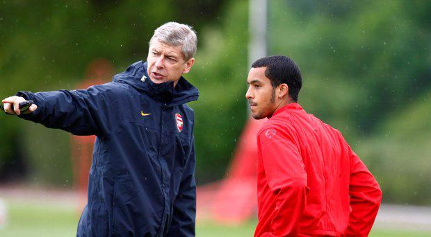 Arsenal manager Arsene Wenger with Theo Walcott in 2009