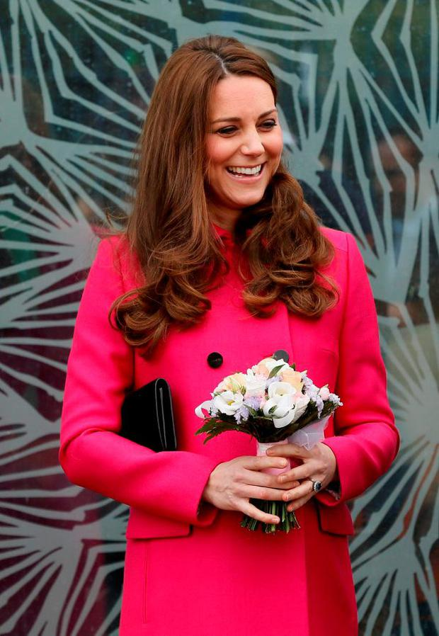 Catherine, Duchess of Cambridge smiles as she leaves the Stephen Lawrence Centre in south east London March 27, 2015. REUTERS/Stefan Wermuth
