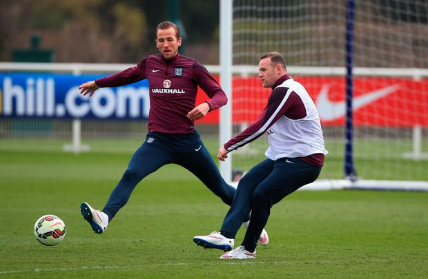 England captain Wayne Rooney as Harry Kane (left) during a training session at the Enfield Training Centre, London