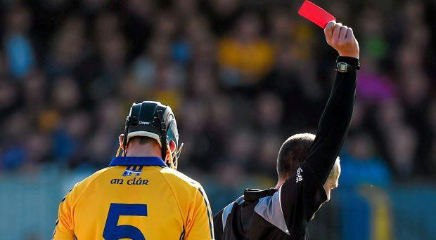 14 March 2015; Brendan Bugler, Clare, is shown a red card by referee Cathal McAllister during the first half. Allianz Hurling League Division 1A Round 4, Clare v Dublin. Cusack Park, Ennis, Co. Clare. Picture credit: Diarmuid Greene / SPORTSFILE