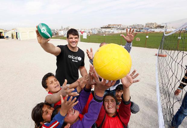 Donncha O'Callaghan pictured with Syrian refugee children at a camp in Lebanon a few weeks ago