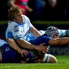 Isaac Boss, Leinster, dives over to score his second, and his side's fourth try of the game, despite the tackle by Jonny Gray, Glasgow Warriors