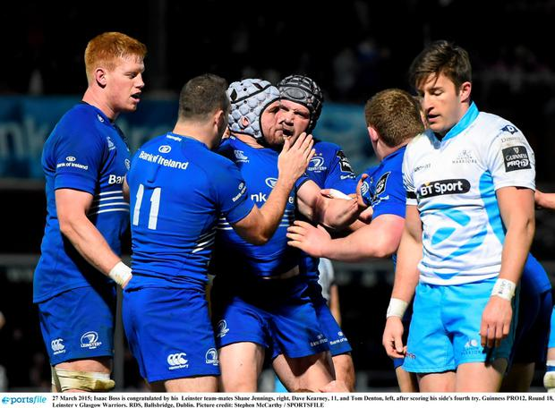 27 March 2015; Isaac Boss is congratulated by his Leinster team-mates Shane Jennings, right, Dave Kearney, 11, and Tom Denton, left, after scoring his side's fourth try. Guinness PRO12, Round 18, Leinster v Glasgow Warriors. RDS, Ballsbridge, Dublin. Picture credit: Stephen McCarthy / SPORTSFILE