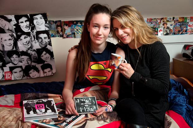 Sophie Hunt Quinn with her mother Carol Hunt as she sits in her bedroom