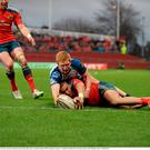28 March 2015; Simon Zebo, Munster, scores his side's second try depite the tackle of Darragh Leader, Connacht. Guinness PRO12, Round 18, Munster v Connacht. Thomond Park, Limerick. Picture credit: Diarmuid Greene / SPORTSFILE