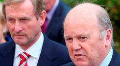 Promises: Taoiseach Enda Kenny and Finance Minister Michael Noonan, along with Tainaiste Joan Burton, have all been hinting at budget giveaways. Photo: Damien Eagers