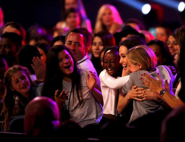 Actress Angelina Jolie is congratulated by her daughters Vivienne (L) and Shiloh after winning the Favorite Villain Award at the 2015 Kids' Choice Awards in Los Angeles, California March 28, 2015.