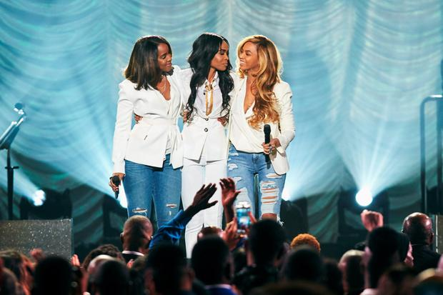 Singers Michelle Williams, Kelly Rowland and Beyonce performing