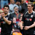 Luis Suarez and Fernando Torres (right) after the Liverpool All Stars Charity match at Anfield