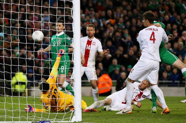 Ireland's Shane Long (L) scores their first goal Action Images via Reuters / Paul Childs