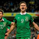 Shane Long celebrates after scoring his side's equalsing goal with team-mate and man of the match Wes Hoolahan.
