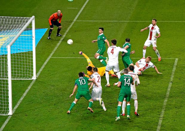 Shane Long scores his side's equalising goal during last night's Euro 2016 Championship Qulaifier against Poland