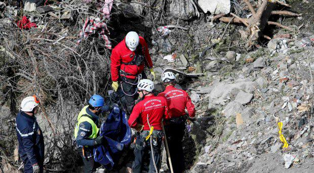 French rescue workers inspect the remains of the Germanwings Airbus A320 at the site of the crash, near Seyne-les-Alpes, French Alps March 29, 2015
