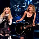LOS ANGELES, CA - MARCH 29: Singers Madonna (L) and Taylor Swift perform 'Ghost Town' onstage during the 2015 iHeartRadio Music Awards which broadcasted live on NBC from The Shrine Auditorium on March 29, 2015 in Los Angeles, California. (Photo by Kevin Winter/Getty Images for iHeartMedia)