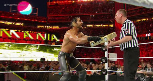 Seth Rollins cashes in his Money in the Bank contract to win the WWE World Heavyweight Championship