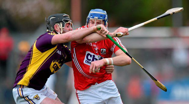 Patrick Horgan, Cork, in action against Eoin Conroy, Wexford