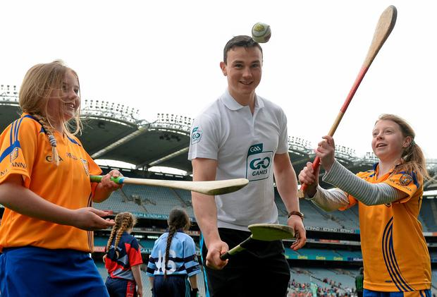 Dublin hurler Liam Rushe with Emily Cryan (left), aged 11, and Liam Kingham, aged 11, from Na Fianna at the launch of the National Go Games in Croke Park
