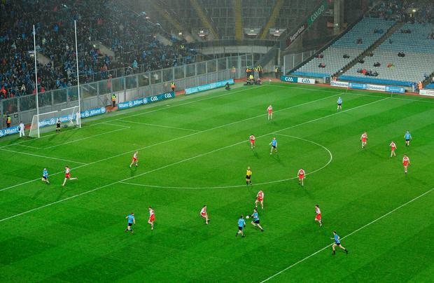 13 Derry players defend against 8 Dublin players during the second half of their Allianz NFL clash in Croke Park