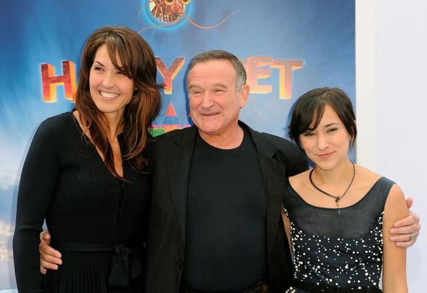 In this Nov. 13, 2011 file photo, Susan Schneider, from left, Robin Williams, and Zelda Williams arrive at the premiere of