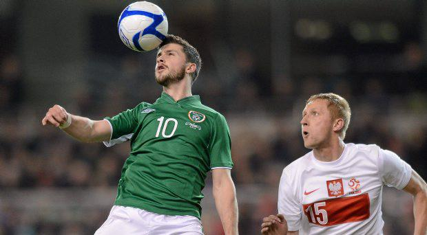 Shane Long, Republic of Ireland, in action against Kamil Glik, Poland