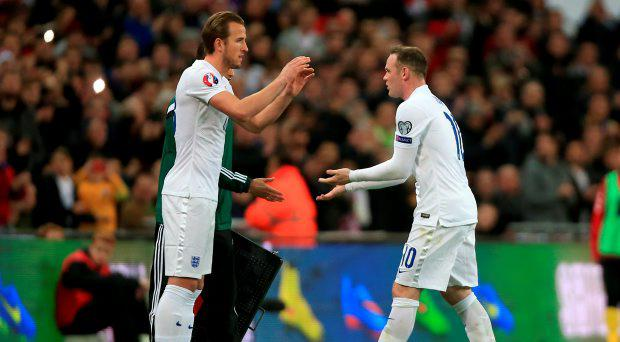 Wayne Rooney (right) being substituted off for Harry Kane during the UEFA 2016 Qualifying, Group E match at Wembley Stadium, London
