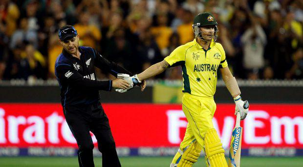 Australia's captain Michael Clarke (R) shakes hands with New Zealand's captain Brendon McCullum after he was dismissed for 74 runs during their Cricket World Cup final match at the Melbourne Cricket Ground (MCG) March 29, 2015