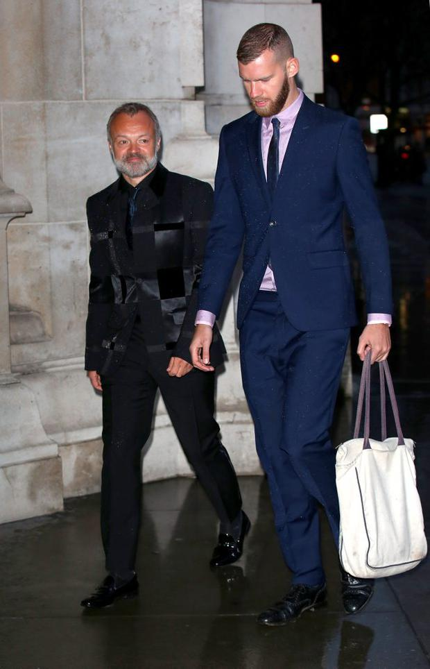 Graham Norton and guest attend the Samsung BlueHouse private view of the Alexander McQueen: Savage Beauty exhibition at Victoria & Albert Museum