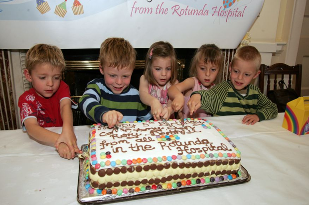 From left: Conor, Cian, Amy, Dearbhail and Rory cut their birthday cake which was sent to them by the Rotunda Hospital in 2008. Photo: Tom Burke
