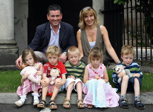 From left: Derbhail, Conor, Rory, Amy and Cian Cassidy with their parents Kevin and Veronica, celebrating their fifth birthday at Dublin' s Rotunda Hospital where they were born prematurely at twenty five and a half weeks. Photo: Niall Carson/ PA