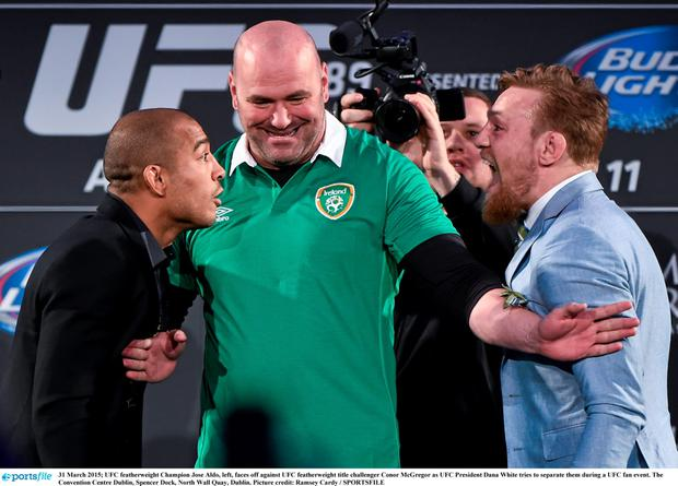 UFC featherweight Champion Jose Aldo, left, faces off against UFC featherweight title challenger Conor McGregor as UFC President Dana White tries to separate them during a UFC fan event. The Convention Centre Dublin, Spencer Dock, North Wall Quay, Dublin. Picture credit: Ramsey Cardy / SPORTSFILE