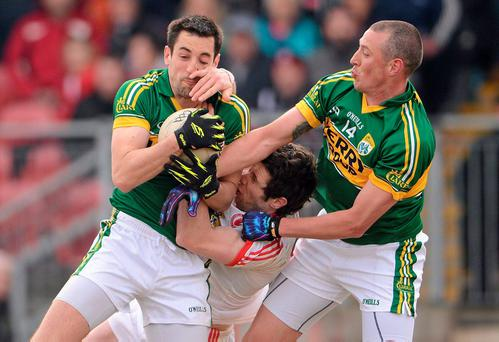 Kerry's Anthony Maher (left) and Kieran Donaghy battle for the ball with Tyrone's Sean Cavanagh in the 2013 league clash