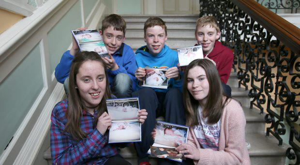 Amy, Conor, Cian, Rory, and Dearbhail Cassidy, holding pictures of when they were just born at the Rotunda Hospital, yesterday they meet some of the staff that cared for them, when they were born there thirteen years ago. The quins were delivered on 16th August 2001 at 25 weeks and 4 days. The quins weighed between 600 grams (1lb 6 oz)